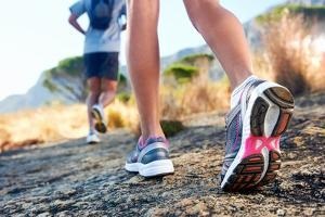 Trail Running Marathon Fitness Feet on Rock Fitness and Healthy Lifestyle by warrengoldswain