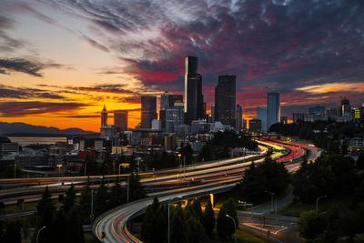 https://imgc.allpostersimages.com/img/posters/washington-seattle-sunset-view-of-downtown-over-i-5-from-the-jose-rizal-bridge_u-L-Q12T1MW0.jpg?p=0