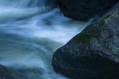 https://imgc.allpostersimages.com/img/posters/water-interacting-with-three-rocks_u-L-Q1CQLHO0.jpg?artPerspective=n