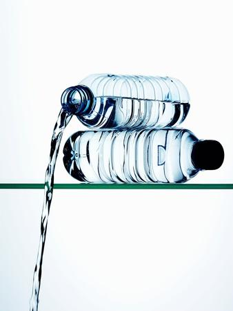https://imgc.allpostersimages.com/img/posters/water-running-out-of-a-plastic-bottle_u-L-Q10SEY10.jpg?p=0