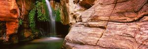 Waterfall Rushing Through the Rocks, Redwall Cavern, Grand Canyon National Park, Arizona, USA
