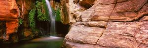 Waterfall Rushing Through the Rocks, Redwall Cavern, Grand Canyon National Park, Arizona, USA