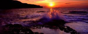 Wave Breaking on Rocks, Bempton, Yorkshire, England, United Kingdom