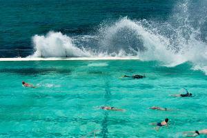 Waves Breaking over Edge of Pool of Bondi Icebergs Swim Club, Bondi Beach, Sydney