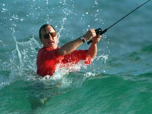 Waves Splash President-Elect George Bush as He Casts a Line While Surf-Fishing