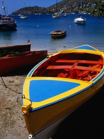 Boat Ashore in Port Elizabeth, Admiralty Bay, St. Vincent & the Grenadines by Wayne Walton
