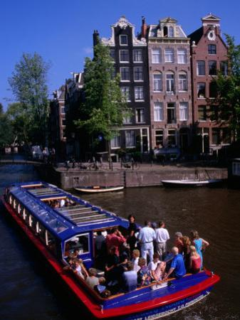 Canal Sightseeing Boat, Amsterdam, Netherlands by Wayne Walton