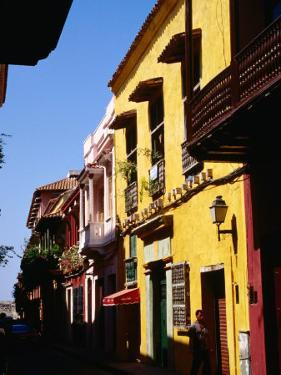 Colonial Facades in Street, Cartagena, Colombia by Wayne Walton