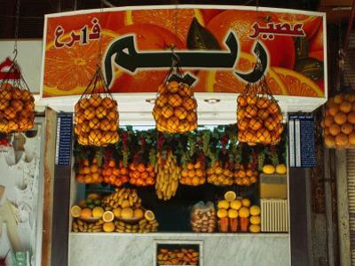 Fruit Juice Stand, Damascus, Syria by Wayne Walton