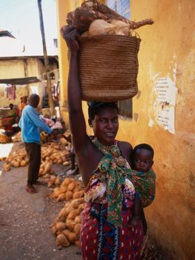 Mother Carrying Baby and Basket, Mombasa, Kenya by Wayne Walton