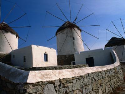 Thatched-Roof Windmills on Plateau, Mykonos Town, Greece by Wayne Walton
