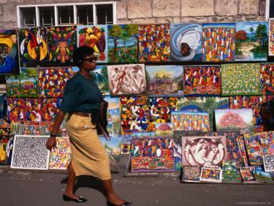 Woman Walking Past Art Stall, St. John's, Antigua & Barbuda by Wayne Walton