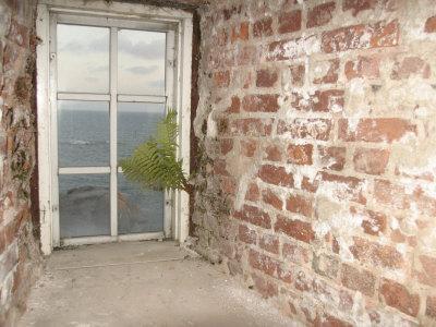 https://imgc.allpostersimages.com/img/posters/weathered-and-worn-brick-walls-and-rustic-window-overlooking-ocean_u-L-Q10X6CW0.jpg?artPerspective=n