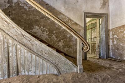 Namibia, Kolmanskop. Banister and Door Inside Abandoned House
