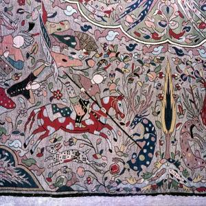 Detail of a Persian style carpet showing hunters on horseback by Werner Forman