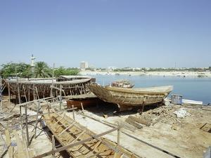 Dhows are still constructed using the traditional methods at Ajman wharf by Werner Forman