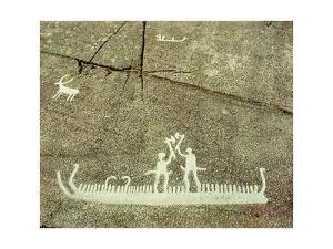Petroglyph depicting phallic figures on board a ship, apparently performing a ceremonial axe dance by Werner Forman