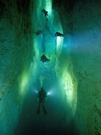 In Stargate Blue Hole, Divers Illuminate North Passage by Wes C. Skiles