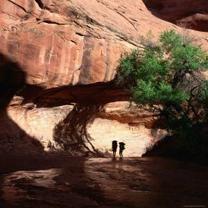 Hikers in Coyote Canyon, Escalante Wilderness, Escalante, USA by Wes Walker