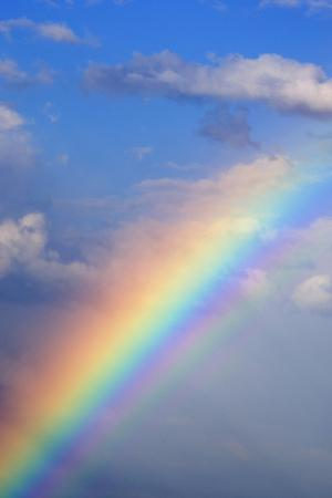 Rainbow with Blue Sky and Clouds by Wesley Hitt