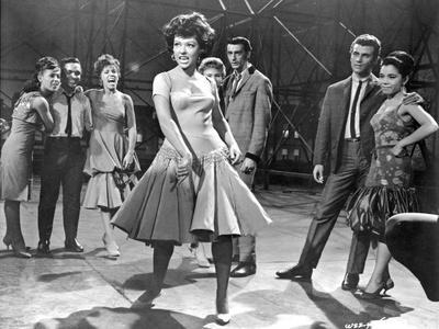 https://imgc.allpostersimages.com/img/posters/west-side-story-woman-in-dress-dancing_u-L-Q117G8S0.jpg?artPerspective=n