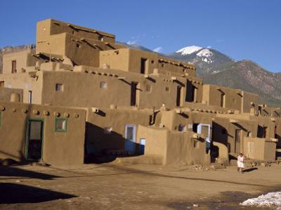 Woman Sweeping Up, in Front of the Adobe Buildings, Dating from 1450, Taos Pueblo, New Mexico, USA