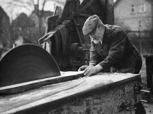 Wheelwright Working with a Circular Saw, February 1935