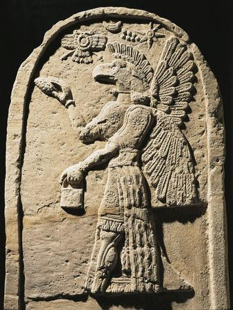 https://imgc.allpostersimages.com/img/posters/white-plaster-bas-relief-depicting-a-winged-genius-with-a-human-body-and-an-eagle-s-head_u-L-POPV1P0.jpg?p=0