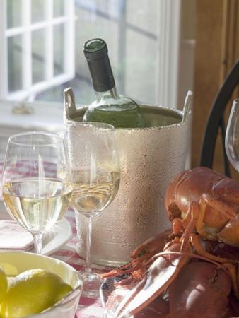 White Wine Bottle in Ice Bucket, Wine Glasses, Lobster, Lemon