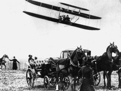 Wilbur Wright with His Plane in Flight at Pau in France, February 1909