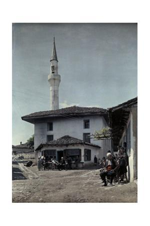 Villagers in Square are Reminded of Islamic Rule with Minaret in View