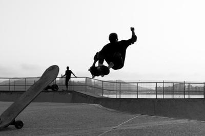 Skateboarder Jumping in a Bowl of a Skate Park by Will Rodrigues