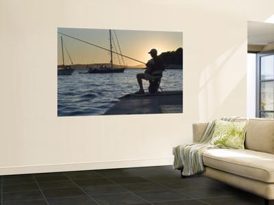 Man Fishing at Sunset at Port