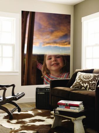 Portrait of Young Girl at Window with Reflection of Clouds at Sunset