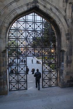 A Pedestrian Walks Through the Old City Gate in Baku by Will Van Overbeek