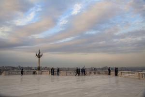 Sightseers Overlook Baku from a Large Courtyard by Will Van Overbeek