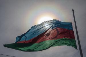 The Sun Shines Through the Azerbaijan National Flag by Will Van Overbeek