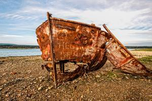 A View of a Rusty Boat on a Beach by Will Wilkinson