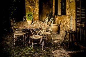 Decorative Table and Chairs on Patio in France by Will Wilkinson