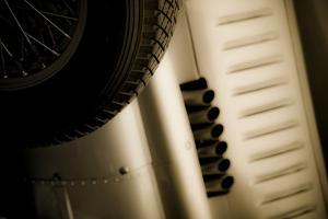 Vintage Racing Car with Exhaust and Air Vents Close Up by Will Wilkinson
