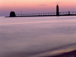 Sunset Light on Grand Haven Lighthouse, MI by Willard Clay