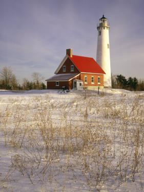 Tawas Point Lighthouse in Winter, Tawas Point State Park, MI by Willard Clay