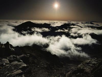 Softened by Haze, the Rising Sun Glows over Patchy Clouds Which Partially Obscure the Crater by William Allen