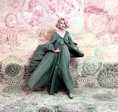 Pose Against a Mural of Swirling Roses, Model Wearing Blue Float of Peignoir in Blue Nylon Yarn