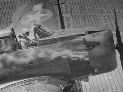American Pilot Safely Landing His Dauntless Dive Bomber as Smoke Pours from the Engine