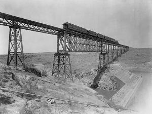 Train Crossing Bridge over Dam by William Henry Jackson