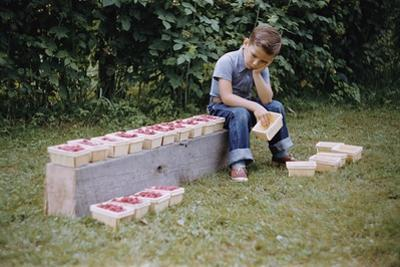 Bored Child Sitting with Raspberry Cartons by William P. Gottlieb