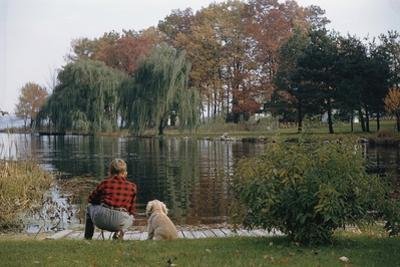 Boy and Dog Looking at Lake by William P. Gottlieb