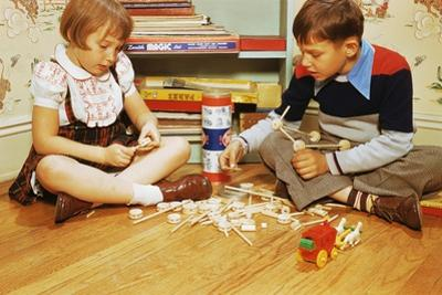 Boy and Girl Playing with Tinkertoys by William P. Gottlieb