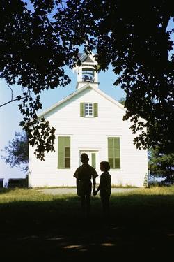 Boy and Girl Waiting Near Schoolhouse by William P. Gottlieb